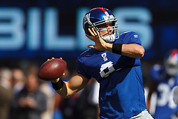 Oct 16, 2011; East Rutherford, NJ, USA; New York Giants quarterback David Carr (8) warms up before the game against the Buffalo Bills at MetLife Stadium. New York defeated Buffalo 27-24. Mandatory Credit: Jason O. Watson-US PRESSWIRE