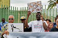 """Roma, 19 Settembre  2014<br /> Manifestazione  contro  ISIS ( Stato Islamico).<br /> Uno striscione con la scritta: """"ISIS non è Islam"""" esposto da un gruppo di italiani ed immigrati davanti alla Moschea Grande  di Roma, durante la preghiera del Venerdi. Manifestanti  con i disegni di artisti siriani contro ISIS<br /> Rome, 19 September 2014 <br /> Demonstration against ISIS (Islamic State). <br /> A banner with the inscription: """"ISIS is not Islam"""" exhibited by a group of Italian and immigrants  in front of the Grand Mosque of Rome, during prayers on Friday. Demonstrators with the designs of Syrian artists against ISIS"""
