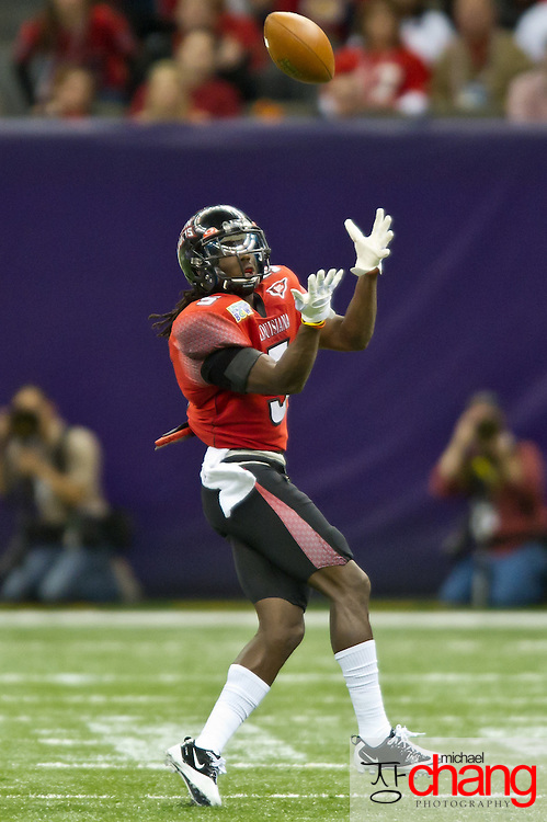 """Louisiana-Lafayette's Dwight """"Bill"""" Bentley CB (5) attempts to catch a pass during the R+L Carriers New Orleans Bowl at the Mercedes-Benz Superdome.  Louisiana-Lafayette defeated San-Diego State 32-30. (Copyright Michael Chang)"""