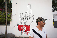 TUNIS, TUNISIA - 25 JULY 2013: Imed Dghiy, 43, of the Men for the Protection of the Revolution is here at the headquarter in the Kram disrtrict, in a former RCD headquarter in Tunis, Tunisia, on July 25th 2013.<br /> <br /> Tunisia, birthplace of the Arab Spring revolutionary movement, was plunged into a new political crisis on Thursday when assassins shot Mohamed Brahmi, 58, leader of the Arab nationalist People's Party, an opposition party leader outside his home in a hail of gunfire.