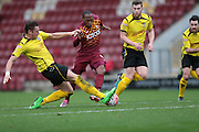 Kyel Reid (Bradford) is tackled on the edge of the box. Penalty? Not this time! during the The FA Cup match between Bradford City and Chesham FC at the Coral Windows Stadium, Bradford, England on 6 December 2015. Photo by Mark P Doherty.