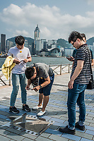 Hong Kong, China - June 9, 2014: people tourist Avenue of Stars Tsim Sha Tsui