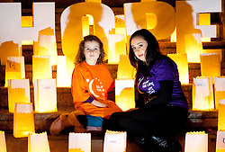 Repro Free: 25/20/2010 Roxane Vance Cronin (5) is pictured with cancer survivor Lorna Rice during a Candle of Hope ceremony to mark the launch of the Global Relay For Life European Summit which is being hosted by the Irish Cancer Society in Dublin today. Pic Andres Poveda..The Global Relay For Life European Summit is an international symposium focusing on how ?We Save Lives? through Relay For Life in communities across the globe. Relay For Life is a 24 hour community celebration event which sees teams of participants take to the track overnight to symbolise the fact that cancer never sleeps. The Irish Cancer Society was chosen this year to host the Summit, which is organised by the American Cancer Society, from the 25th-27th of October 2012....To find out more about Relay For Life, visit www.relayforlife.ie or call 1850 60 60 60. ..ENDS. .For further information, please contact:.Grainne O'Rourke / Órla Sheils.Communications, Irish Cancer Society.E: gorourke@irishcancer.ie / osheils@irishcancer.ie .T: 01 231 0546 / 01 231 055 / 087 9707709