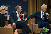 Former Presidents George W. Bush and Bill Clinton participate in a moderated discussion at a graduation ceremony of the first class of the Presidential Leadership Scholars program at the George W. Bush Presidential Center in Dallas on Thursday, July 9.  (Cooper Neill for The New York Times)