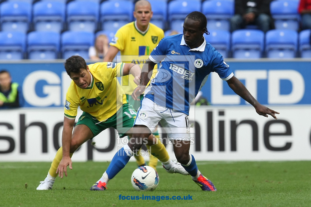 Wes Hoolahan of Norwich and Victor Moses of Wigan Athletic in action during the Barclays Premier League match at the DW Stadium, Wigan...Picture by Paul Chesterton/Focus Images Ltd. .07904 640267.13/8/11