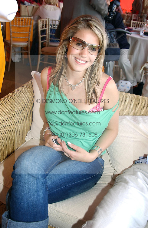 MISS KATIE ALEXANDER-TAYLOR at the Veuve Clicquot sponsored Gold Cup or the British Open Polo Championship won by The  Azzura polo team who beat The Dubai polo team 17-9 at Cowdray Park, West Sussex on 18th July 2004.