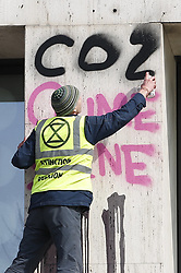 © Licensed to London News Pictures. 15/04/2019. London, UK. Extinction Rebellion protestors spray paint a message as they occupying part of Shell Headquarters as protests take hold throughout London and other UK cities to highlight global climate change. Photo credit: Peter Macdiarmid/LNP