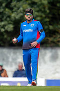 Afghan bowler Hamid Hassan prepares to bowl during the One Day International match between Scotland and Afghanistan at The Grange Cricket Club, Edinburgh, Scotland on 10 May 2019.