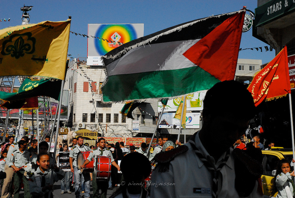 Members of the Al Amari Brass Band marching through the streets of the city center of Ramallah, during the festival of Music, celebrated in more than 210 cities over the world on the 21st of June. This time extra attention was brought on peace and music and not internal fighting between Palestinians. Ramallah, West Bank, Palestine, 2007