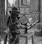 Sandblasting the joints of a bicycle frame; operator wears helmet with breathing tube and a protective tunic: France.  Wood engraving Paris 1896.