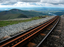 UK WALES LLANBERIS 15JUN08 - Tracks of the Snowdon Mountain Railway on Mount Snowdon, the highest mountain in England and Wales. The Snowdon Mountain Railway (Welsh: Rheilffordd yr Wyddfa) is a narrow gauge rack and pinion mountain railway in Gwynedd, north-west Wales. It is a tourist railway that travels for 4.675 miles  (7.524 km) to the summit of Snowdon, the highest peak in Wales. It is the only public rack and pinion railway in the United Kingdom and after more than 100 years of service it remains a highly popular tourist attraction...jre/Photo by Jiri Rezac ..© Jiri Rezac 2008..Contact: +44 (0) 7050 110 417.Mobile:  +44 (0) 7801 337 683.Office:  +44 (0) 20 8968 9635..Email:   jiri@jirirezac.com.Web:    www.jirirezac.com..© All images Jiri Rezac 2008 - All rights reserved.