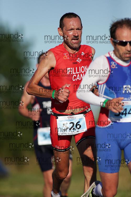 (Ottawa, Canada---10 August 2013)  Jean-Fran?ois Fillion (526)  of Canada (CAN) competing in the 50-54 Male AG International Triathlon Union 2013 World Duathlon Championships (10 km run- 40 km bike- 5km run).