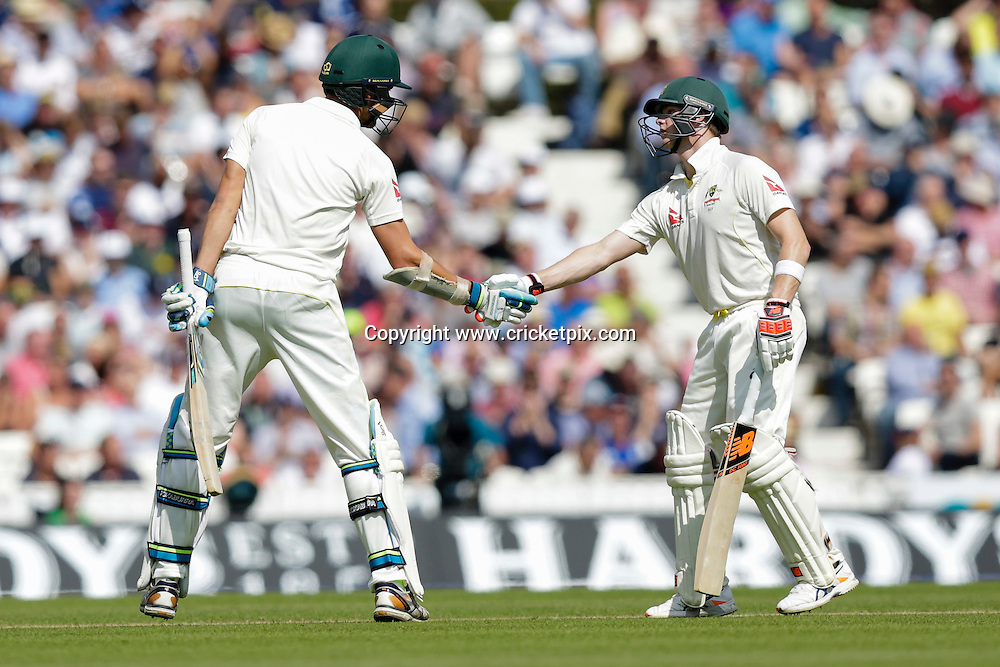 21.08.2015. London, England. Investec Ashes 5th Test, day 2.  England versus Australia.  Australia's Mitchell Starc  (left) is congratulated by Steve Smith on his half century
