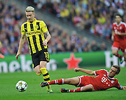UEFA Champions League final football match between Borussia Dortmund and Bayern Munich at Wembley Stadium in London on May 25, 2013, Bayern Munich won the game 2-1 <br />Marco Reus of Borussia Dortmund (L) in action with Philipp Lahm of Bayern Muenchen<br />(Photo by: Piotr Hawalej)