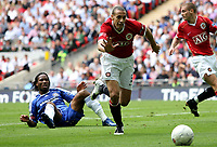 Photo: Paul Thomas.<br /> Chelsea v Manchester United. The FA Cup Final. 19/05/2007.<br /> <br /> Rio Ferdinand (Red) of Utd runs after the ball after Didier Drogba isn't fouled (Ground).
