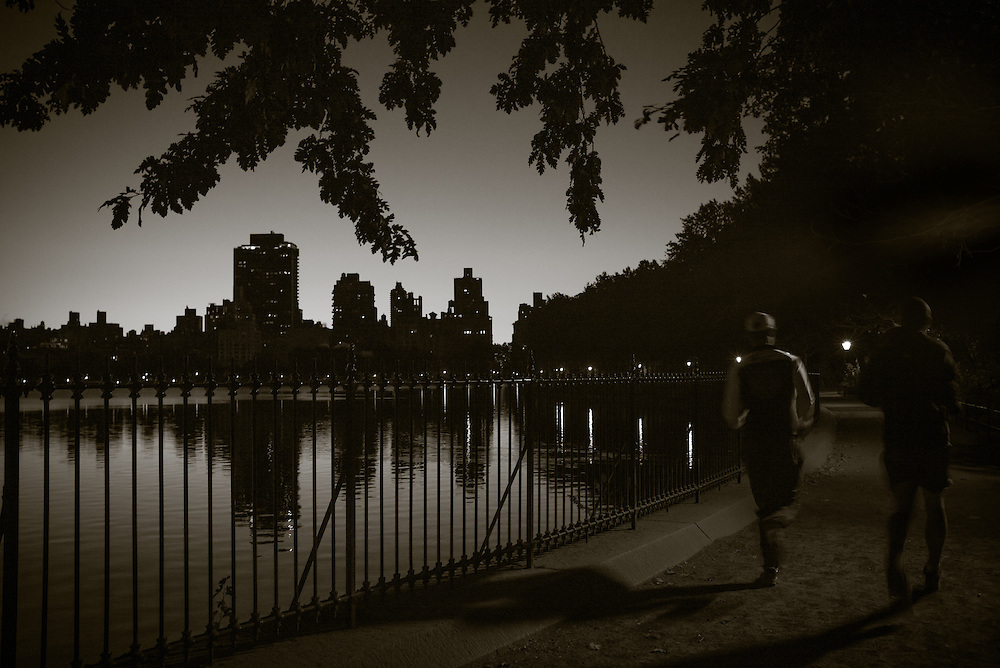 Runners at the Jacqueline Onassis Reservoir, Central Park, New York City.