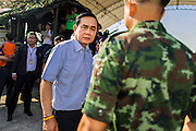 "11 JANUARY 2014 - BANGKOK, THAILAND: General PRAYUTH CHAN-OCHA, Commender in Chief of the Thai Royal Army, walks through a Children's Day fair in Bangkok. The Royal Thai Army hosted a ""Children's Day"" event at the 2nd Cavalry King's Guard Division base in Bangkok. Children had an opportunity to look at military weapons, climb around on tanks, artillery pieces and helicopters and look at battlefield medical facilities. The Children's Day fair comes amidst political strife and concerns of a possible coup in Thailand. Gen Prayuth has issued mixed signal on a coup at one point saying there wouldn't be one, and later saying he wouldn't talk about a possible coup. Earlier in the week, the Thai army announced that movements of armored vehicles through Bangkok were not in preparation of a coup, but were moving equipment into position for Children's Day.      PHOTO BY JACK KURTZ"