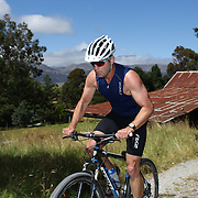 A competitor in action in the Paradise Triathlon and Duathlon series, Paradise, Glenorchy, South Island, New Zealand. 18th February 2012. Photo Tim Clayton
