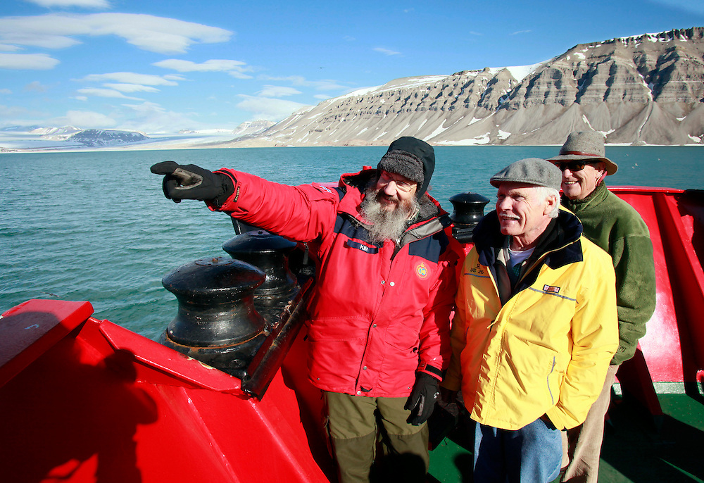 Kim Holmen, research director for the Norwegian Polar Institute, points out the Tuna Glacier to Founder and Chairman of the UN Foundation, Ted Turner, center, and former U.S. Senator Timothy E. Wirth, president of the UN Foundation, right, during a trip to view first-hand and discuss the issues related to climate change and the environment in the arctic circle region of Svalbard, Norway, Thursday, June 23, 2011. (Stuart Ramson for United Nations Foundation)
