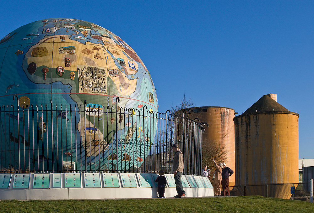 People viewing the Eco-Earth globe in Riverfront Park, Salem, Oregon. The globe was created from a wood pulp mill acid ball.