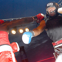 Amateur Heavyweights Dakota Walker (right) and Mingo Brown box during ``Big Fighters, Big Cause'' charity boxing event at the Santa Monica Pier on Tuesday, May 25, 2010. Walker won the bout by decision..