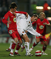 Photo: Paul Thomas.<br /> Blackburn Rovers v Basle. UEFA Cup. 02/11/2006.<br /> <br /> Blackburn's Morten Gamst Pedersen (L) tries to get the ball from Ivan Rakitic (White).