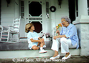 Active Aging Senior Citizens, Retired, Activities, Giving Grandmother Flowers, Child Happy to Give Grandmother Flowers,