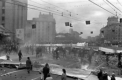 Muscovite build barricades in downtown of Moscow during a constitutional crisis in Moscow, Russia, 02 October 1993. The constitutional crisis of 1993 was a political stand-off between the Russian president and the Russian parliament that was resolved by using military force. The relations between the president and the parliament had been deteriorating for a while. The constitutional crisis reached a tipping point on 21 September 1993, when President Boris Yeltsin purported to dissolve the country's legislature (the Congress of People's Deputies and its Supreme Soviet), although the president did not have the power to dissolve the parliament according to the then-current constitution. Yeltsin used the results of the referendum of April 1993 to justify his actions. In response, the parliament declared that the president's decision was null and void, impeached Yeltsin and proclaimed vice president Aleksandr Rutskoy to be acting president.The situation deteriorated at the beginning of October. On 3 October, demonstrators removed police cordons around the parliament and, urged by their leaders, took over the Mayor's offices and tried to storm the Ostankino television centre. The army, which had initially declared its neutrality, by Yeltsin's orders stormed the Supreme Soviet building in the early morning hours of 4 October, and arrested the leaders of the resistance. The ten-day conflict had seen the deadliest street fighting in Moscow since October 1917.[2] According to government estimates, 187 people were killed and 437 wounded, while sources close to Russian communists put the death toll at as high as 2,000.
