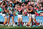 James Tedesco celebrates scoring with teammates. Sydney Roosters v Vodafone Warriors. NRL Rugby League. Sydney Cricket Ground, Sydney, Australia. 18th August 2019. Copyright Photo: David Neilson / www.photosport.nz