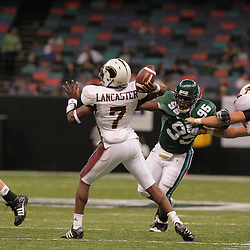 20 September 2008: Tulane defensive tackle Justin Adams (95) pressures Louisiana-Monroe quarterback Kinsmon Lancaster (7) during a Conference USA match up between the University of Louisiana Monroe and Tulane at the Louisiana Superdome in New Orleans, LA.