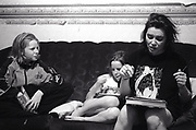 Mother and daughters sitting on a sofa Newport South Wales