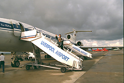 LIVERPOOL, ENGLAND - Monday, September 11, 1995: Liverpool's Neil Ruddock boards the Aeroflot Tupolev Tu-154 RA-85715 aircraft at Liverpool Airport before the squad travel to Russia ahead of the UEFA Cup 1st Round 1st Leg match against FC Alania Spartak Vladikavkaz. (Photo by David Rawcliffe/Propaganda)