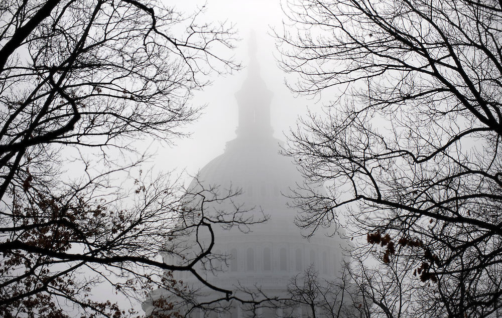 The dome of the US Capitol is pictured through the morning fog, in Washington, DC, USA on 14 December 2009. US lawmakers are back in session today, wrestling over the health care reform legislation among other issues.