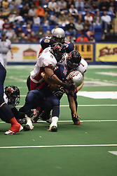 14 April 2007: C.J. Jones applies a hand to the face of Rocky Harvey to help bring down Harvey during a United Indoor Football League game that pitted the RiverCity Rage who won 29-11 against the Bloomington Extreme at the U.S. Cellular Coliseum in Bloomington Illinois..