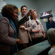 US representatives Aaron Schock, IL, and Laura Richardson, CA, meet with girls attending Biruh Tesfa in Addis Ababa, during their CARE Learning Tour to Ethiopia. Biruh Tesfa means bright future in Amharic, and is a program for urban adolescent girls at risk of exploitation and abuse. For many girls, going to Biruh Tesfa is their only hope of an education and a repite from their domestic work. ..The program promotes functional literacy, life skills, livelihoods skills, and HIV/reporductive health education through girls' clubs led by adult female mentors. The girls' clubs are held in meeting spaces donated by the kebele (local administration).