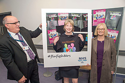 Scottish Health Secretary Shona Robison joins NHS Fife Chief Executive Paul Hawkins and Chair of NHS Fife Tricia Marwick in their Flu Fighters campaign during a visit to the Victoria Hospital in Kirkcaldy.<br /> <br /> &copy; Dave Johnston/ EEm
