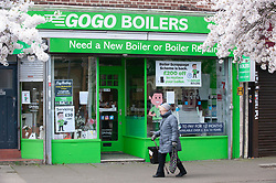 ©Licensed to London News Pictures 20/03/2020<br /> New Eltham, GoGo Boilers in New Eltham have put a notice of help and support for NHS staff in their shop window. UK. Coronavirus threat. People out and about at their local shops in New Eltham, South East London. Photo credit: Grant Falvey/LNP