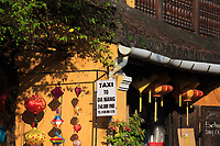 Bright yellow walls, colourful lanterns and slate rooves are features of the old town of Hoi An, Vietnam