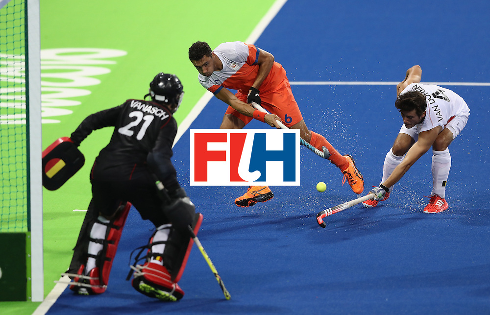 RIO DE JANEIRO, BRAZIL - AUGUST 16: Glenn Schuurman of the Netherlands crosses the ball as Arthur van Doren tackles during the Men's semi final hockey match between Belgium and the Netherlands on Day 11 of the Rio 2016 Olympic Games held at the Olympic Hockey Centre on August 16, 2016 in Rio de Janeiro, Brazil.  (Photo by David Rogers/Getty Images)