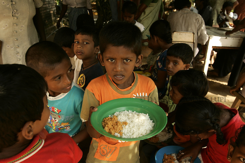 Children homeless since the tsunami have lunch at a Buddhist temple in Mirissa on the south coast of Sri Lanka on January 15, 2005..Photo by Darrin Zammit Lupi