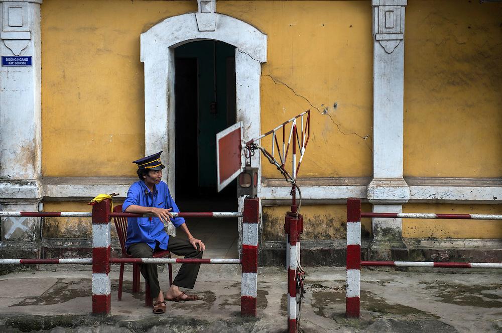 Guard at level crossing, Hue