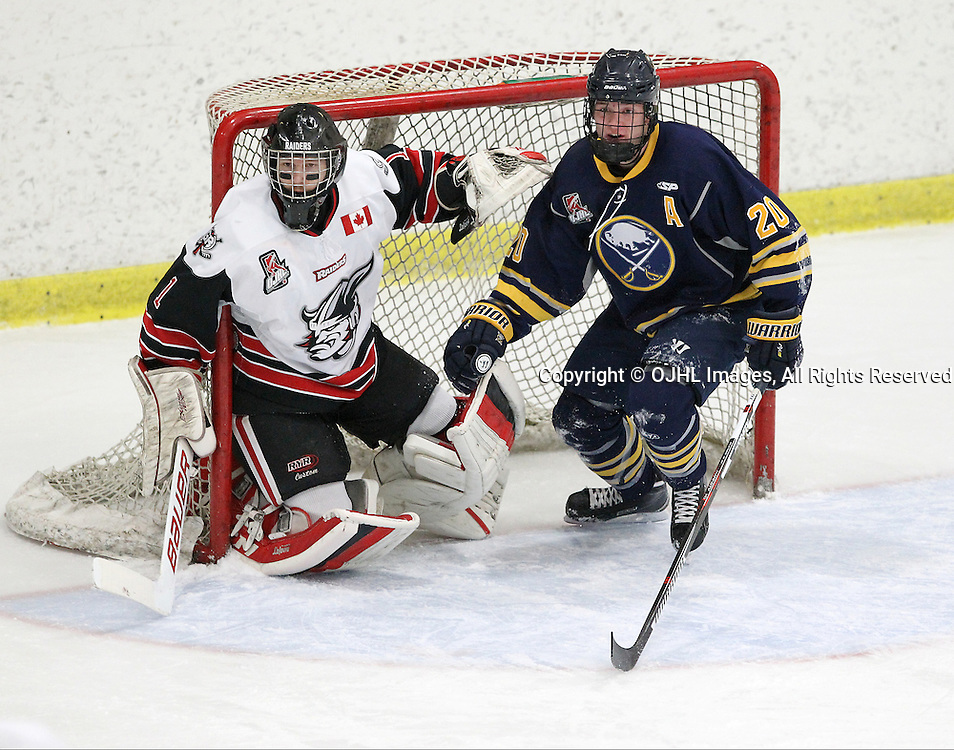 GEORGETOWN, ON  - MAR 2,  2017: Ontario Junior Hockey League, playoff game between the Georgetown Raiders and the Buffalo Jr Sabres. Erik Urbank #20 of the Buffalo Jr. Sabres gets knocked into the crease of Raider's Goaltender Josh Astorino during the first period.<br /> (Photo by Tim Bates / OJHL Images)