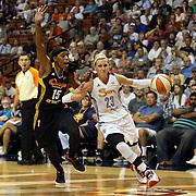 Katie Douglas, (right), Connecticut Sun, drives past Roneeka Hodges, Tulsa Shock, during the Connecticut Sun Vs Tulsa Shock WNBA regular season game at Mohegan Sun Arena, Uncasville, Connecticut, USA. 3rd July 2014. Photo Tim Clayton