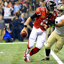 Oct 15, 2015; New Orleans, LA, USA; New Orleans Saints outside linebacker Kasim Edebali (91) sacks Atlanta Falcons quarterback Matt Ryan (2) during the first quarter of a game at the Mercedes-Benz Superdome. Mandatory Credit: Derick E. Hingle-USA TODAY Sports