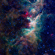 NASA's WISE captured this image of a hidden star-forming cloud of dust and gas located in the constellation of Cepheus.