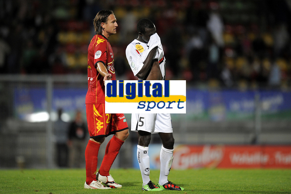 FOOTBALL - FRENCH CHAMPIONSHIP 2010/2011 - L2 - LE MANS FC v US BOULOGNE - 10/09/2010 - PHOTO JEAN MARIE HERVIO / DPPI - DESPAIR ZARGO TOURE (USB) / THORSTEIN HELSTAD (LMFC)