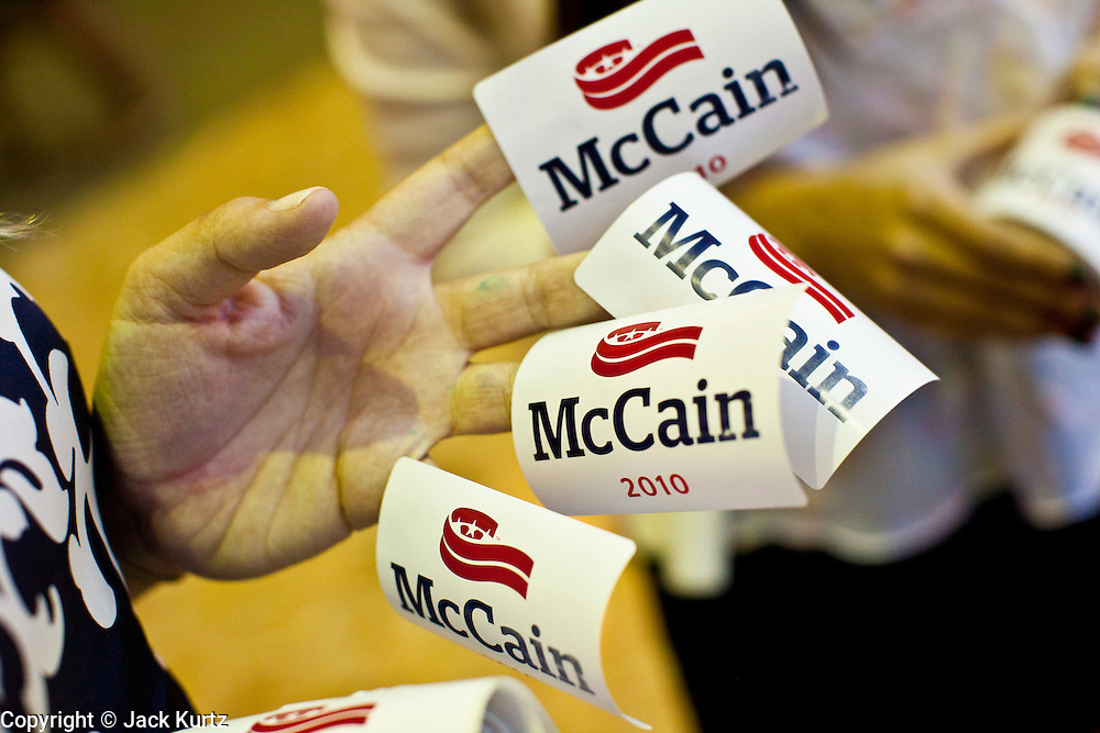Aug. 23, PHOENIX, AZ: A volunteer hands out stickers for Sen John McCain at his campaign office in Phoenix. US Sen. John McCain held the final of his primary election campaign at his campaign offices in Phoenix Monday. McCain, Arizona's senior Republican US Senator, is facing former Congressman JD Hayworth in the primary, Tuesday, Aug. 24. McCain has outspent Hayworth by a considerable margin and is expected to win.   Photo by Jack Kurtz