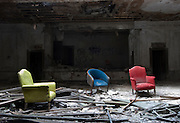 Three colorful chairs are all that's left of the ballroom at the former American Hotel, near Downtown Detroit.