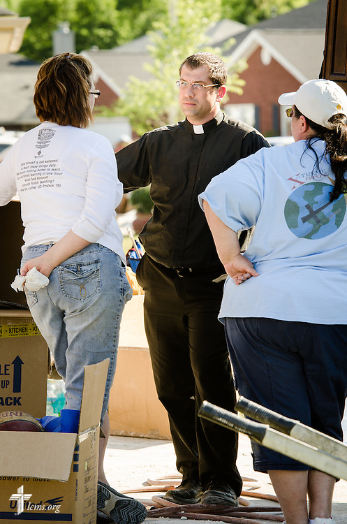 The Rev. Ross Johnson talks to volunteers in a flood-damaged neighborhood of Pensacola, Fla., on Saturday, May 3, 2014. LCMS Communications/Erik M. Lunsford