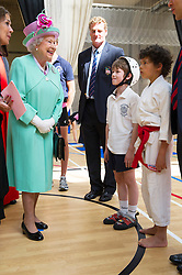 Image ©Licensed to i-Images Picture Agency. 12/06/2014. London, United Kingdom. In the frame - HM The Queen meeting teachers and pupils. <br /> HM The Queen today officially opens the new Westminster School's sports Centre for Westminster School. HM watched an array of sports including judo, fencing cricket and yoga. Picture by  i-Images